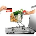 Køb af dagligvarer på nettet - indkøbsvogn og computer