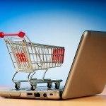 Online shopping - indkøbsvogn og computer